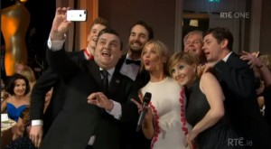 Simon and co-host Laura Whitmore take a selfie at the IFTAs