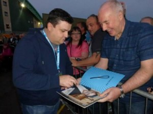 Simon Delaney signs programmes after Mrs Brown's Boys